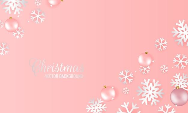 スノーフレークピンクのグラデーション。飾りボールで飾られたプレゼンテーションのクリスマスの背景。