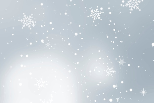 Snowflakes falling over gray background