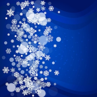 Snowflakes frame on blue background with sparkles.