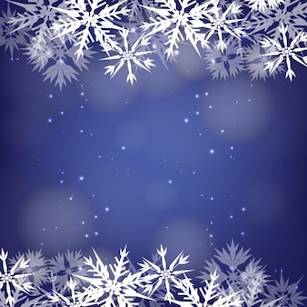 Snowflakes frame on a bokeh blue background