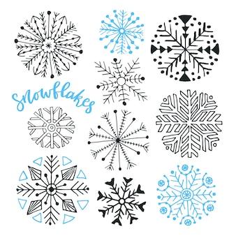 눈송이 손으로 그린 벡터 컬렉션. 크리스마스와 새 해 설계를위한 겨울 격리 장식