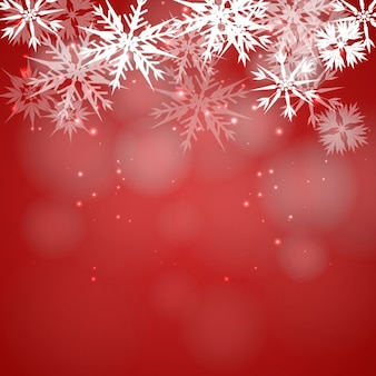 赤のボケの背景に雪片
