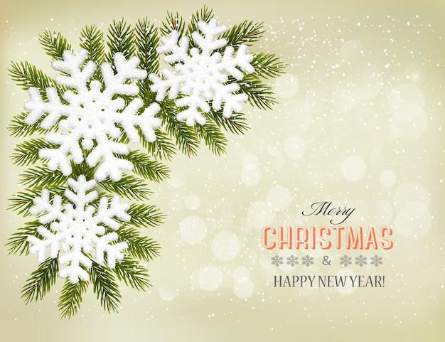 Снежинки на ветвях елки. рождественский праздник фон.