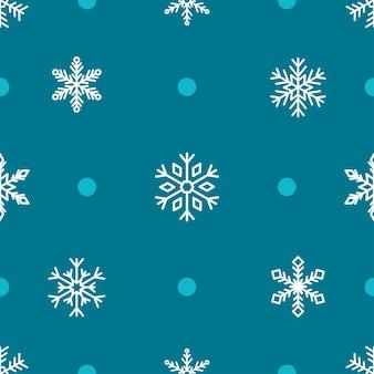 青の背景に雪片のシームレスなパターン。フラットスタイルのクリスマスベクトルイラスト。