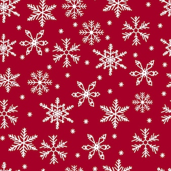 Snowflakes seamless pattern. white snow on red background. merry christmas.
