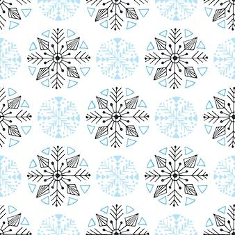 スノーフレークシームレスパターン。冬の背景装飾。クリスマスラッピングペーパー。
