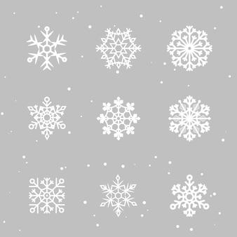 雪片を設定します。多くの白い冷たいフレーク要素。白い雪が空を飛んでいます。スノーフレーク