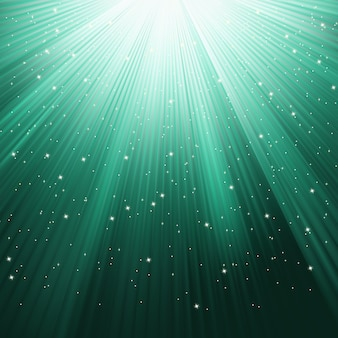 Snowflakes and stars descending on a path of green light.   file included