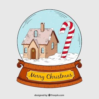 Snowglobe con disegnata a mano bella casa e zucchero filato