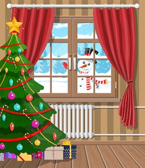 Snowman looks in living room window. interior of room with christmas tree and gifts. happy new year decoration. merry christmas holiday. new year and xmas celebration.