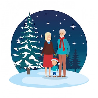 Пара бабушек и дедушек с внуком в snowscape