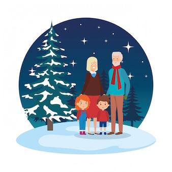 Пара бабушек и дедушек с детьми в snowscape