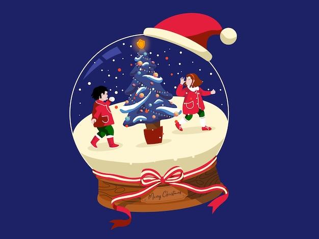 その中で遊んでいる子供たちと雪に覆われたクリスマスボール