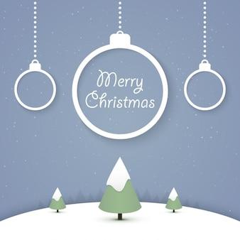 青色の背景に雪に覆われたクリスマスツリー
