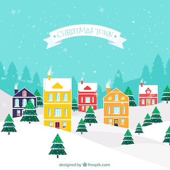 Snowy city with colorful christmas houses
