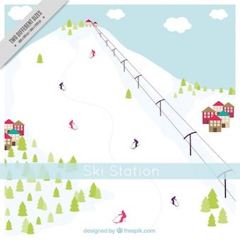 雪に覆われた高い山の背景とスキーリゾート