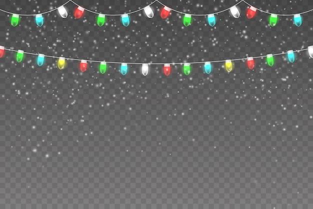 軽い花輪と雪片のある雪の夜
