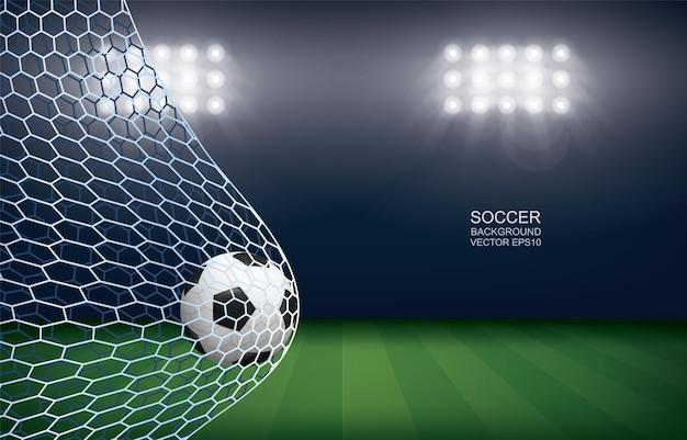 Soccer ball in goal. football ball and white net in soccer field stadium background. vector illustration.