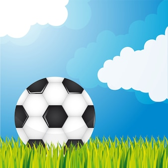 Soccer ball over grass and sky background