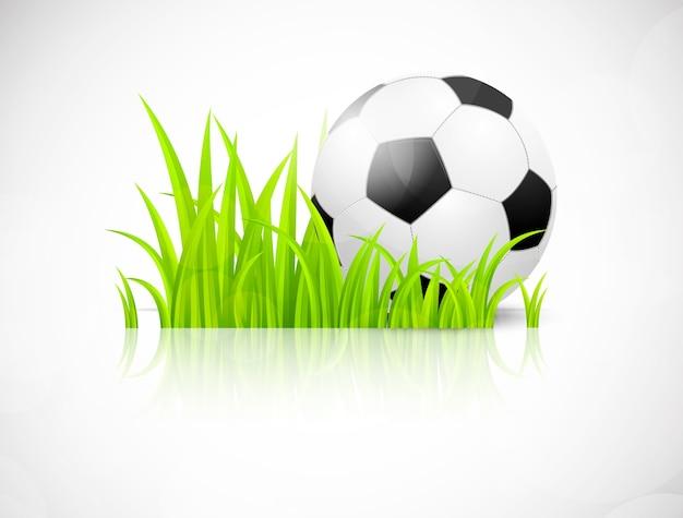 Футбольный мяч на зеленой траве. яркая иллюстрация
