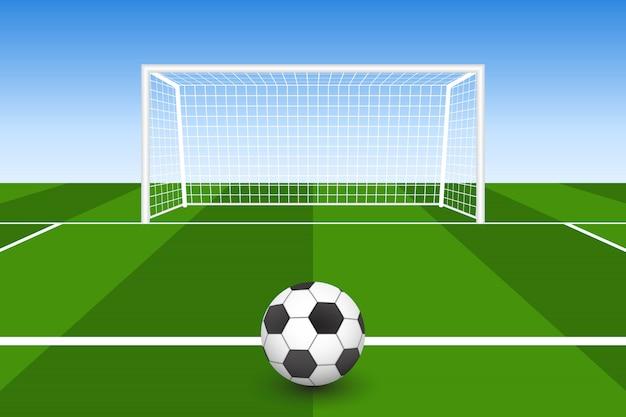 目標図の前の芝生の上のサッカーボール