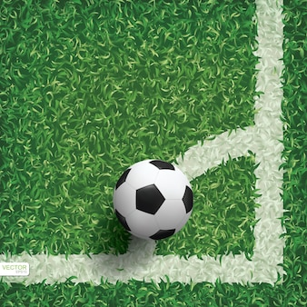 Soccer football ball in corner area of soccer field.