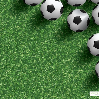 Soccer football ball on green grass field for background.