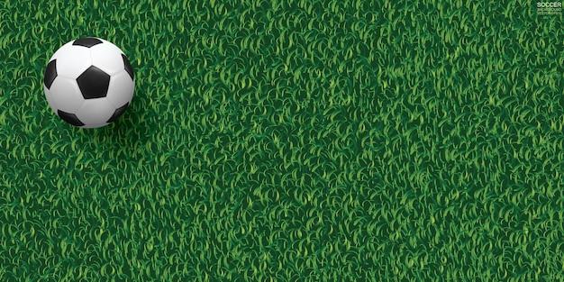 サッカー場の背景の緑の芝生の上のサッカーサッカーボール。ベクトルイラスト。