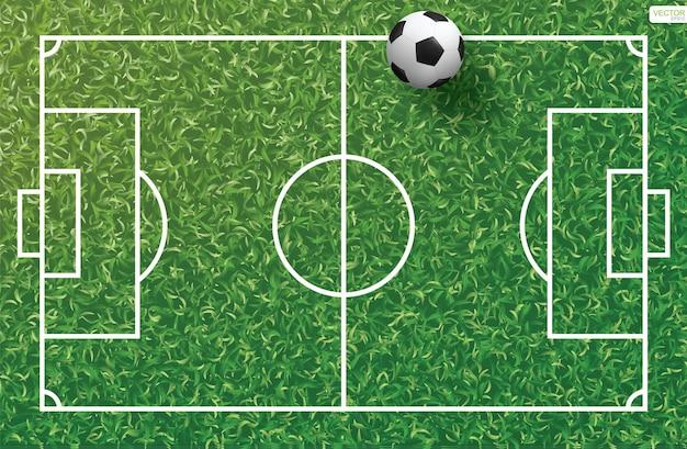サッカー場のパターンとテクスチャの背景の緑の芝生の上のサッカーサッカーボール。ベクトルイラスト。
