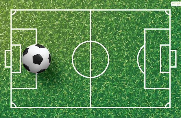 Футбольный мяч на зеленой траве образца футбольного поля и фона текстуры. векторная иллюстрация.