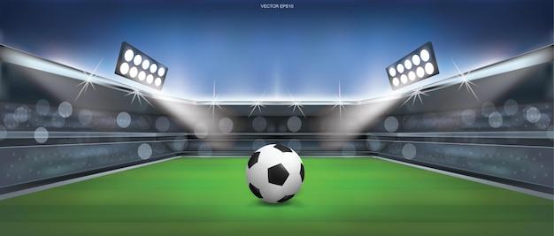 Футбольный мяч на зеленой траве на фоне стадиона футбольного поля. векторная иллюстрация.