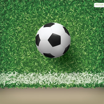 Soccer football ball in soccer field pattern and texture background.