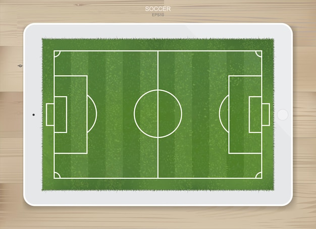 サッカーゲームとサッカー戦術のアイデアを作成するためのタブレット画面の表示でサッカーサッカー場の背景。ベクトルイラスト。