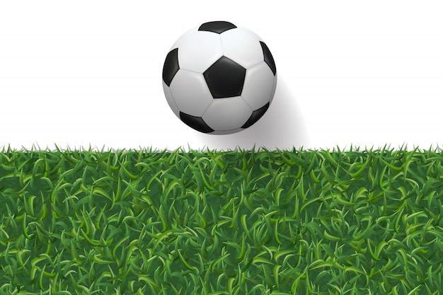 Soccer football and green grass texture for background.