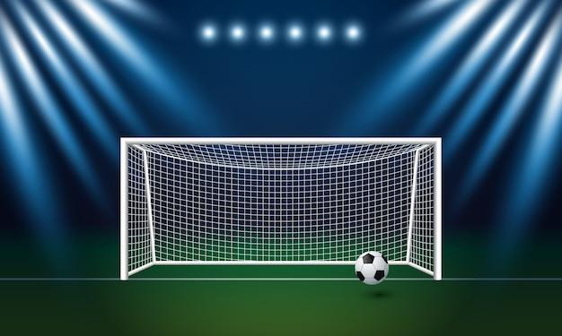 サッカーの目標とスタジアムでのスポットライトの背景とサッカー