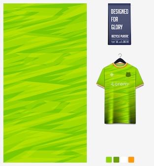 緑の背景にサッカージャージー生地パターンデザイン抽象的なパターン