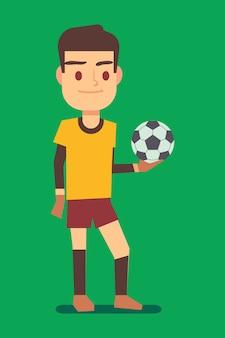 Футболист с мячом зеленое поле