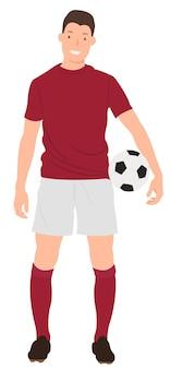 赤いスポーツウェアでサッカーを保持しているサッカー選手