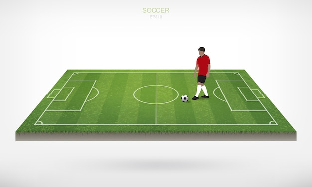 Soccer player and soccer football ball in area of soccer field with white background.