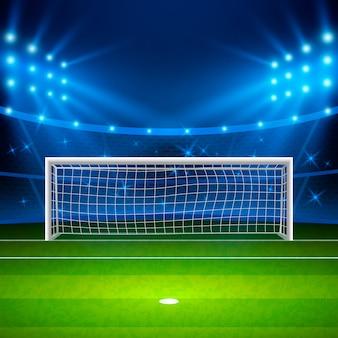 サッカースタジアム。スタジアムの緑のサッカー場、夜のアリーナは明るいスポットライトを照らしました。