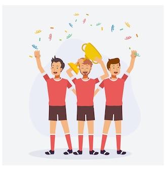トロフィーゴールデンカップを祝うサッカーチームの選手