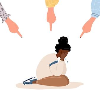 Социальное издевательство. пальцы, указывающие на грустную африканскую девушку.