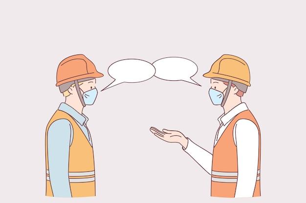 パンデミックの概念の間の仕事での社会的距離。 covid-19ウイルスを防ぐために、工場での作業で一緒に話している間、立って距離を保つ医療用保護フェイスマスクの男性労働者