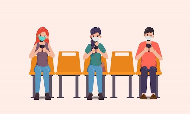 Концепция социального дистанцирования людей, сидящих, чтобы предотвратить коронавирус covid-19.