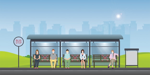 Social distancing concept with people wearing medical masks at the bus stop.
