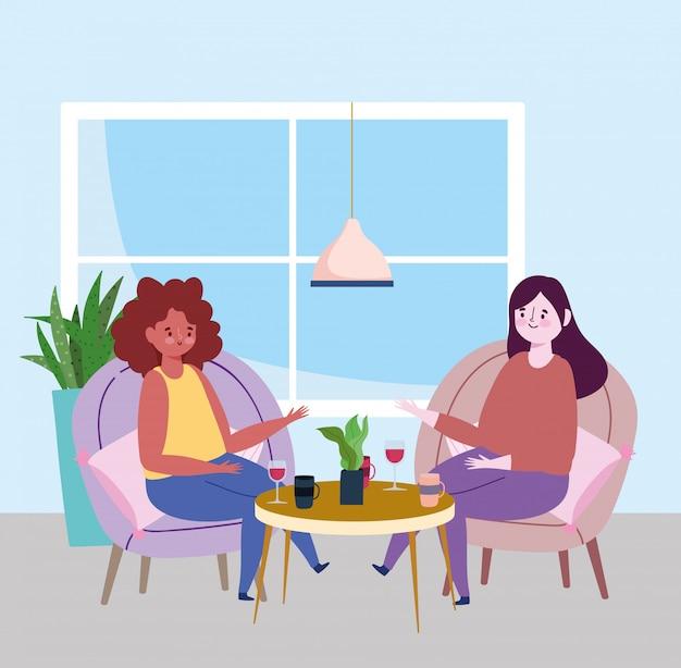 Социальный дистанционный ресторан или кафе, женщины разговаривают с бокалом вина, держатся на расстоянии