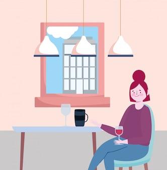 사회적 거리 레스토랑이나 카페, 와인 컵 혼자 앉아있는 젊은 여성
