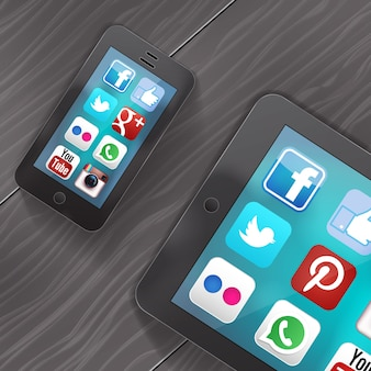 Social media icons on screen of ipad and iphone