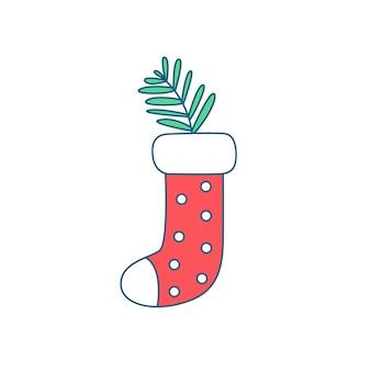 針葉樹の枝で新年の贈り物のための靴下