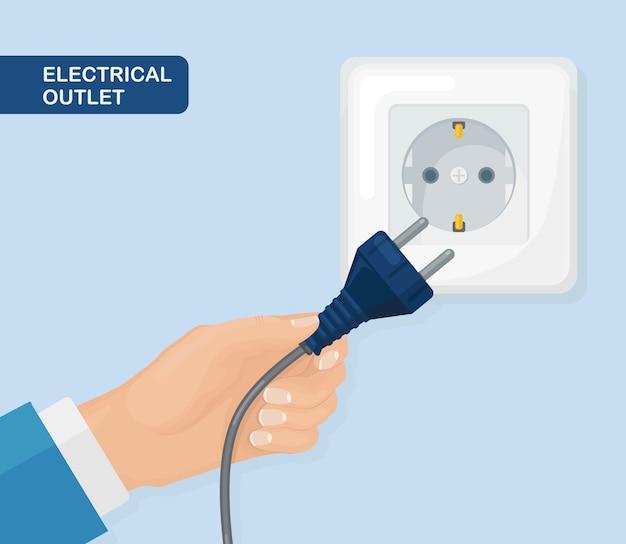 手にプラグが付いているソケット。電気。家庭用電気の接続と切断
